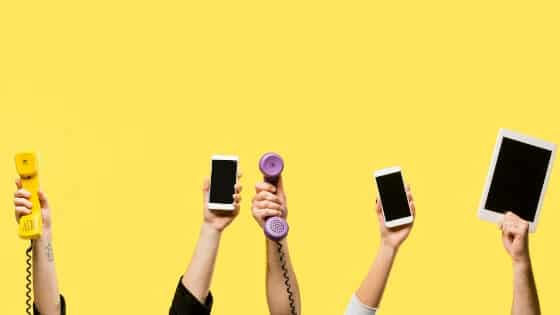Hands holding up different kinds of phones - why are we so scared of using them for conversation?